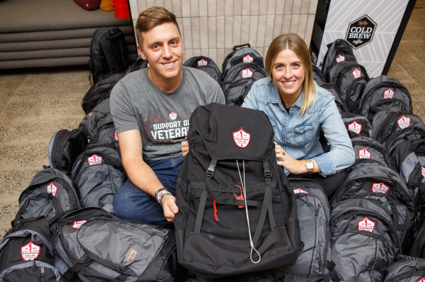 Backpacks For Life founders Brett and Alexa featured here with the backpack they designed and engineered specifically for our veterans living in shelters and on the streets.