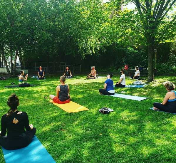 Canco Park community yoga takes place in a bucolic natural setting lowering stress